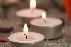 Beautiful Spa composition with aroma candles on wooden Royalty Free Stock Photo