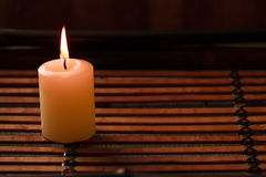 Beautiful Spa composition with aroma candles on wooden Royalty Free Stock Images