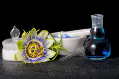 Beautiful spa composition of blue passiflora flower, cosmetic sa Royalty Free Stock Photo