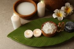 Beautiful spa composition with coconut body care products. And candles on table Royalty Free Stock Image