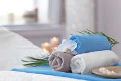 Beautiful spa composition on massage table stock image