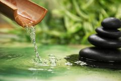 Beautiful spa composition with pouring water. And stones Stock Photo