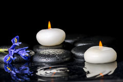 Beautiful spa concept of blooming iris flower, candles and black Royalty Free Stock Photography