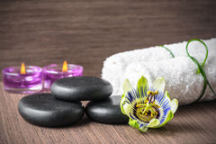 Beautiful spa concept of passiflora flower, black zen stones, pu Royalty Free Stock Photo