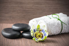 Beautiful spa concept of passiflora flower, black zen stones and Royalty Free Stock Image