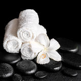 Beautiful spa concept of white hibiscus flower and towels on zen Stock Photo