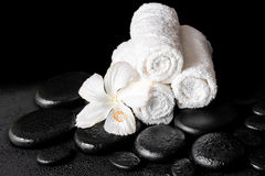 Beautiful spa concept of white hibiscus flower and towels on zen Royalty Free Stock Image