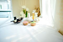 A beautiful spa element on a white fabric floor called a couch. royalty free stock photography