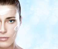 Beautiful Spa Girl with Cream on Her Face. Skincare concept Stock Photos
