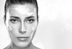Beautiful Spa Girl with Cream on Her Face. Skincare concept Royalty Free Stock Photography