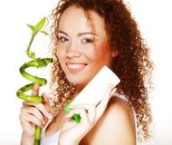 Beautiful spa girl holding jar of cream and bamboo stock image