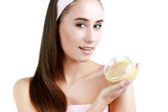 Beautiful spa girl holding jar of cream isolated on white backgr. Young and healthy woman in spa salon Stock Images