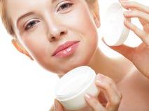 Beautiful spa girl holding jar of cream Stock Photos