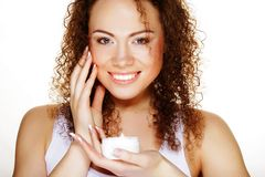 Beautiful spa girl holding jar of cream Stock Image