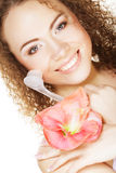 Beautiful spa girl holding pink flower and brush Stock Photos