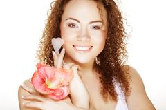 Beautiful spa girl holding pink flower and brush Stock Photography