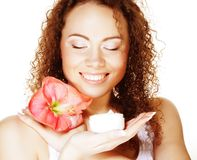 Beautiful spa girl holding pink flower and cream Stock Images