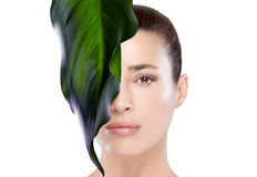 Beautiful Spa Girl with Leaf on Her Face Royalty Free Stock Image