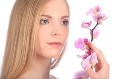 Beautiful Spa Girl With Orchid Flowers Skincare concept Royalty Free Stock Photos
