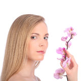 Beautiful Spa Girl With Orchid Flowers Skincare concept Royalty Free Stock Photo