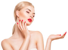 Beautiful spa girl showing empty copy space on the hand palm Royalty Free Stock Photo