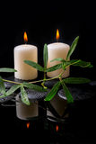 Beautiful spa setting of green tendril passionflower, candles Stock Photo