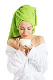 Beautiful spa woman in bathrobe and turban. Stock Image