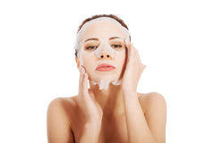 Beautiful spa woman with collagen mask. Stock Photography
