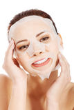 Beautiful spa woman with collagen mask. Stock Photos