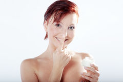 Beautiful spa woman with cream in hand Stock Image