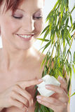 Beautiful spa woman with cream in hand Royalty Free Stock Photography