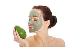 Beautiful spa woman in facial mask and avocado Royalty Free Stock Images