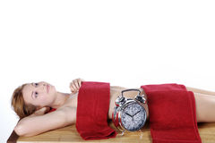 Beautiful spa woman with glittering clock Royalty Free Stock Images