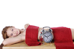 Beautiful spa woman with glittering clock Stock Images
