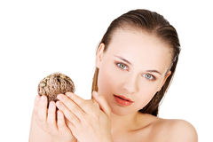 Beautiful spa woman holding Rose of Jericho Royalty Free Stock Photography
