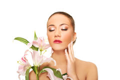 Beautiful spa woman with lily. Stock Images