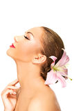 Beautiful spa woman with lily. Stock Photography