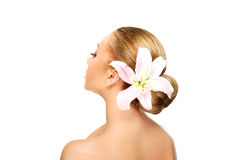 Beautiful spa woman with lily. Royalty Free Stock Image