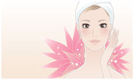 Beautiful spa woman with lotus. Beautiful spa woman touching her face after beauty treatment on a lotus flower background. Skin care. Relaxation Stock Photos