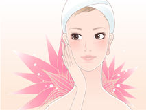 Beautiful spa woman with lotus. Beautiful spa woman touching her face after beauty treatment on a lotus flower background. Skin care. Relaxation Stock Images