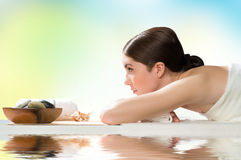 Beautiful spa woman lying on the couch Royalty Free Stock Photos