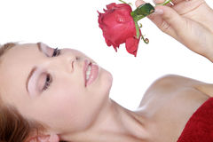 Beautiful spa woman lying down with red rose Stock Images