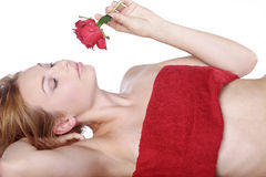Beautiful spa woman lying down with red rose Royalty Free Stock Photo