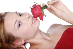 Beautiful spa woman lying down with red rose Stock Photography
