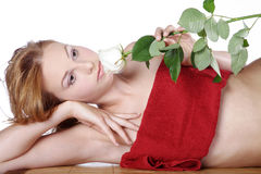 Beautiful spa woman lying down with red rose Royalty Free Stock Images