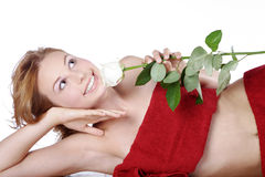 Beautiful spa woman lying down with red rose Royalty Free Stock Image