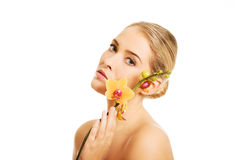 Beautiful spa woman with orange orchid Royalty Free Stock Photo
