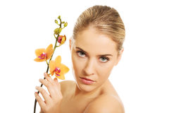 Beautiful spa woman with orange orchid Royalty Free Stock Image