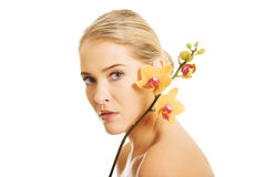 Beautiful spa woman with orange orchid Stock Photo