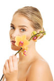 Beautiful spa woman with orange orchid Royalty Free Stock Photography